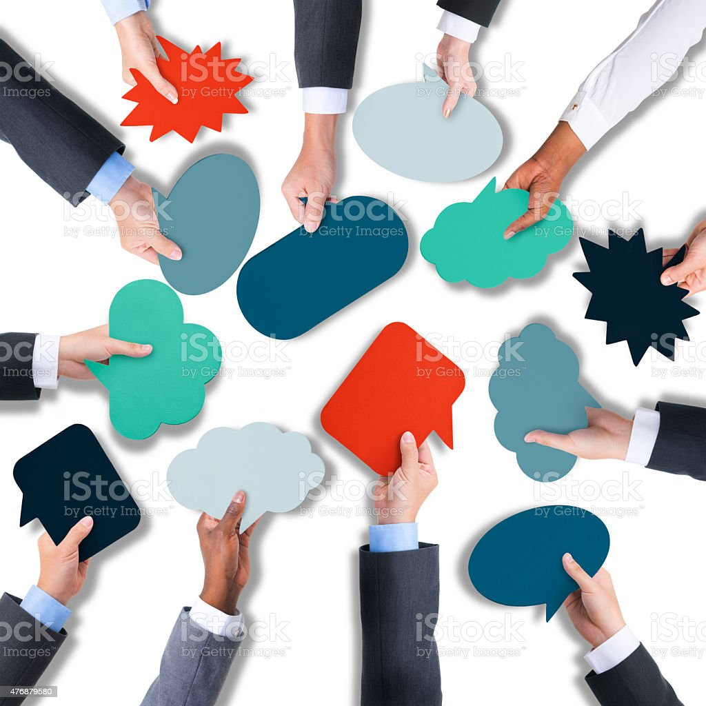 Group of Hands Holding Speech Bubble stock photo