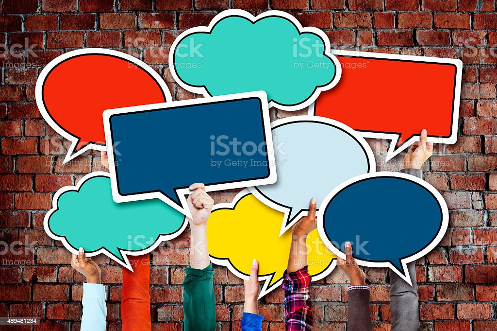 Group of Hands Holding Speech Bubbles stock photo