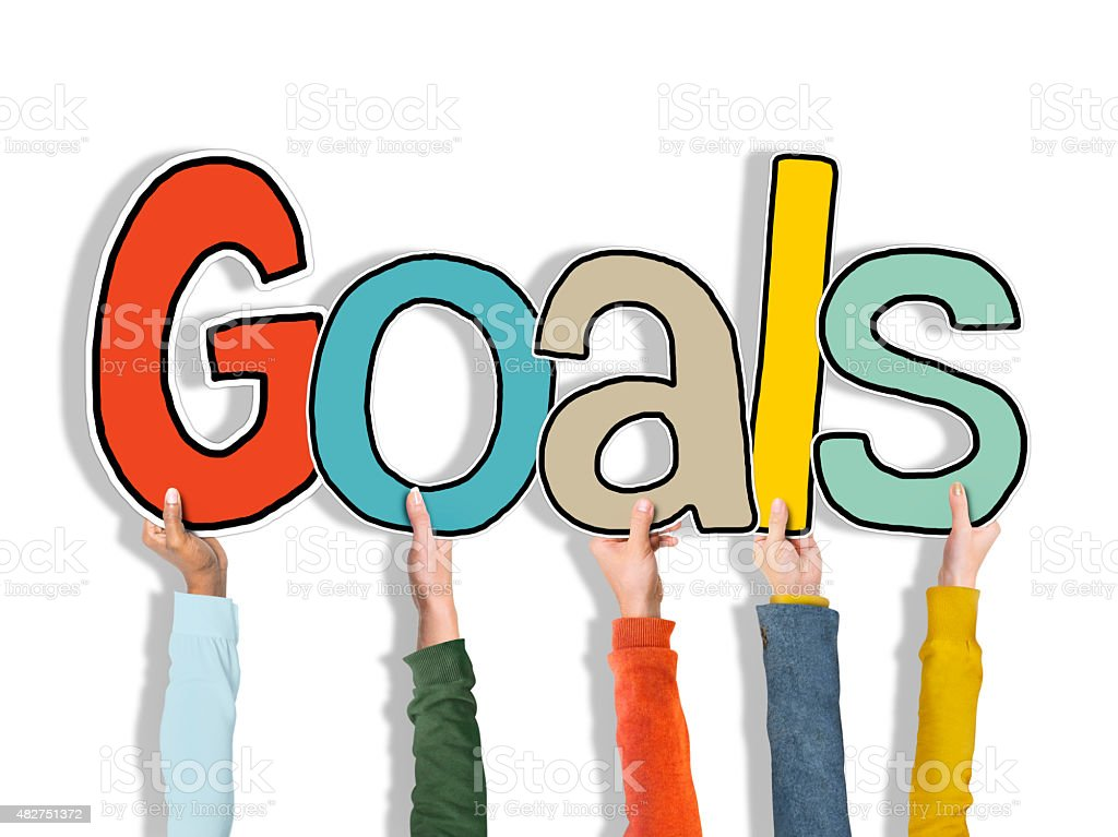 Group of Hands Holding Word Goals stock photo