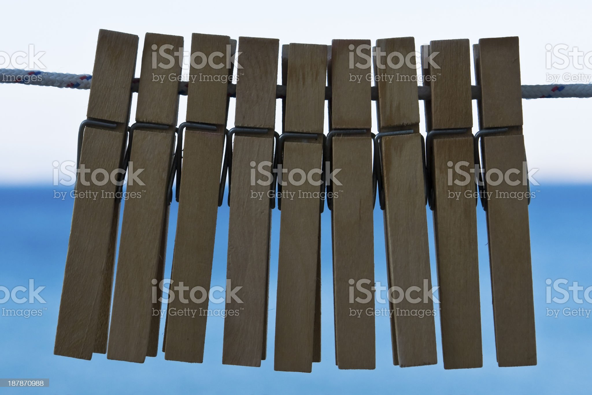 Group of hanging pegs royalty-free stock photo