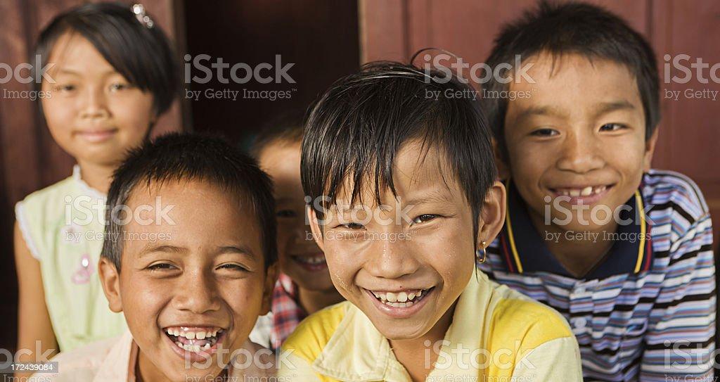 Group of happy Burmese children royalty-free stock photo