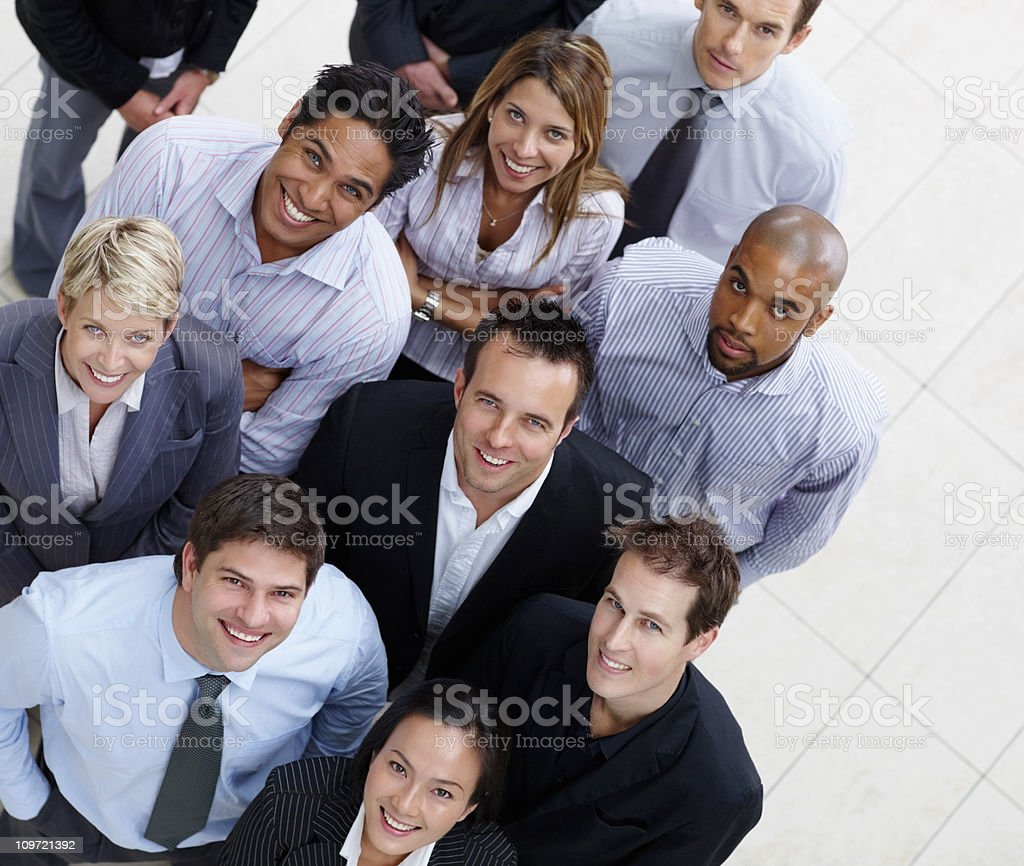 Group of happy business colleagues looking up royalty-free stock photo