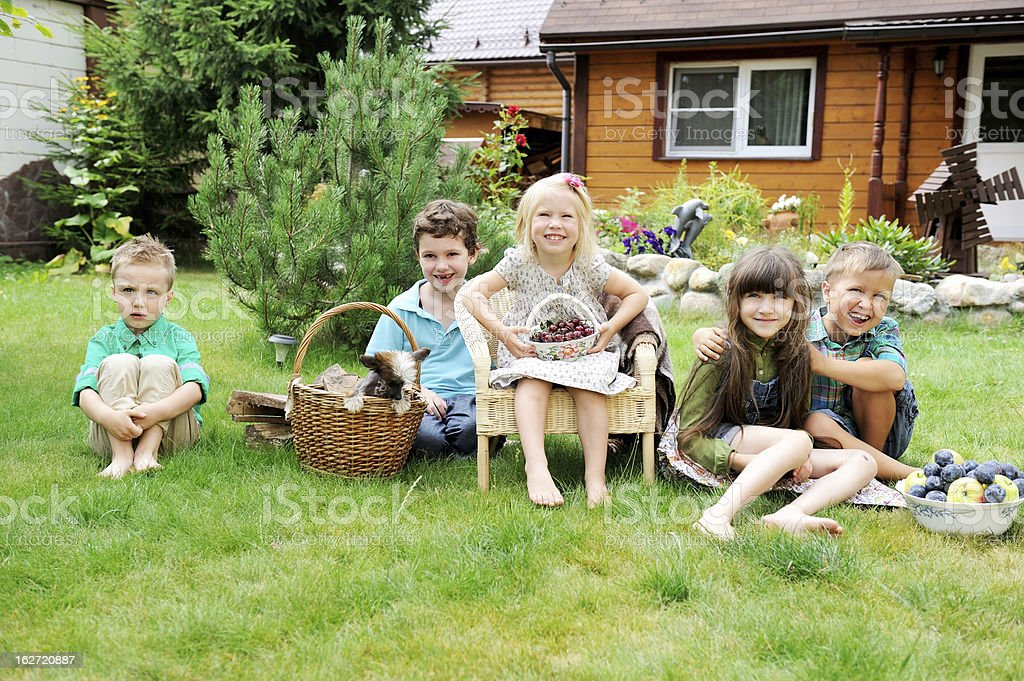 Group of happy children playing outdoors in park royalty-free stock photo