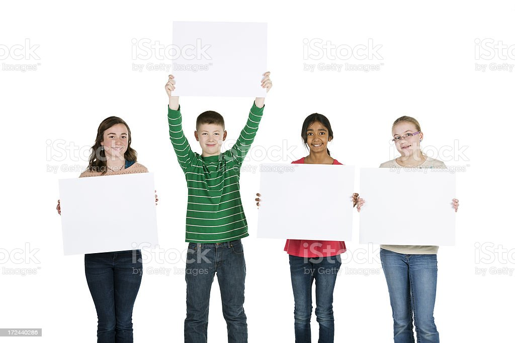Group of happy diverse 11-year old kids holding blank signs royalty-free stock photo