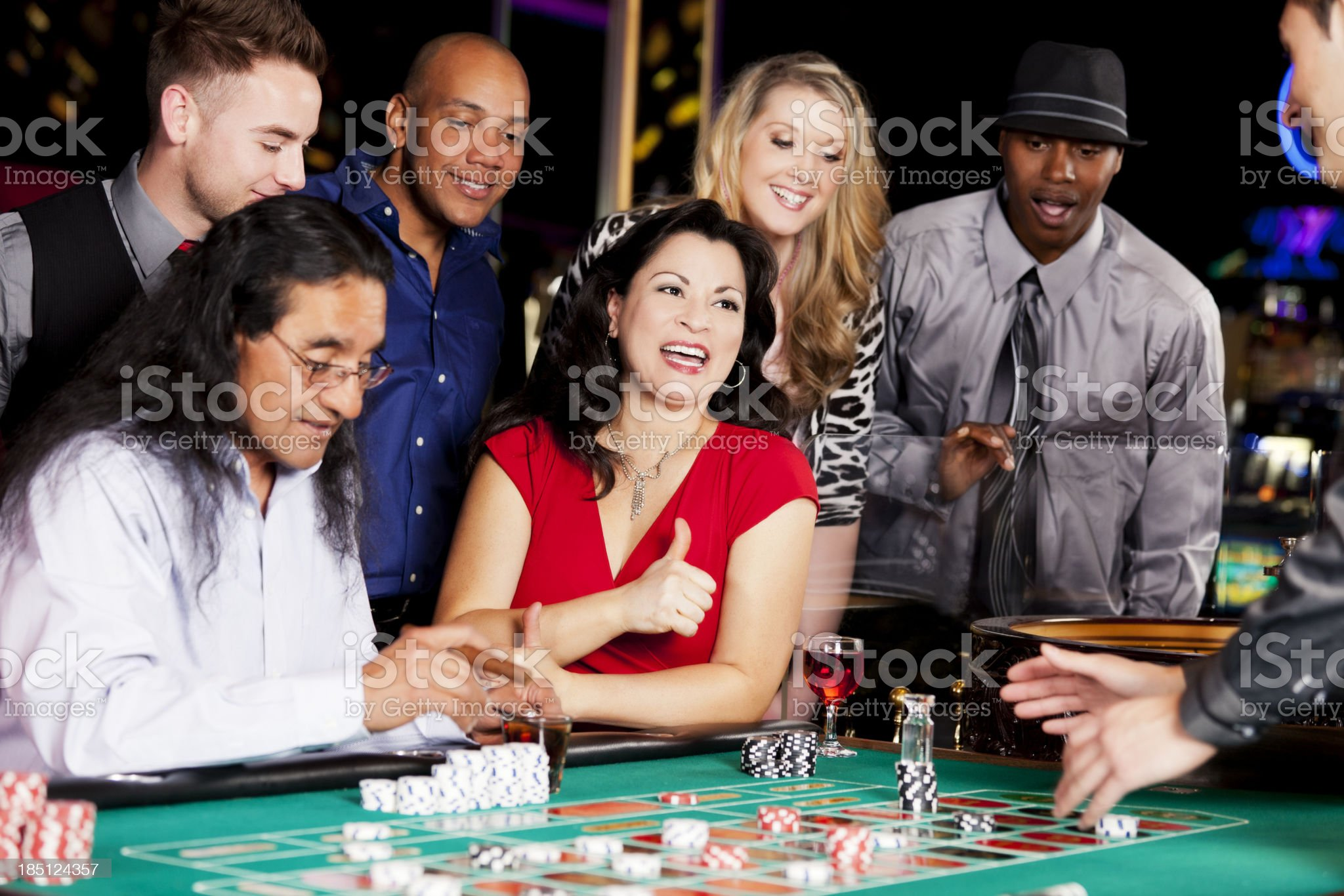 Group of happy diverse people playing roulette royalty-free stock photo
