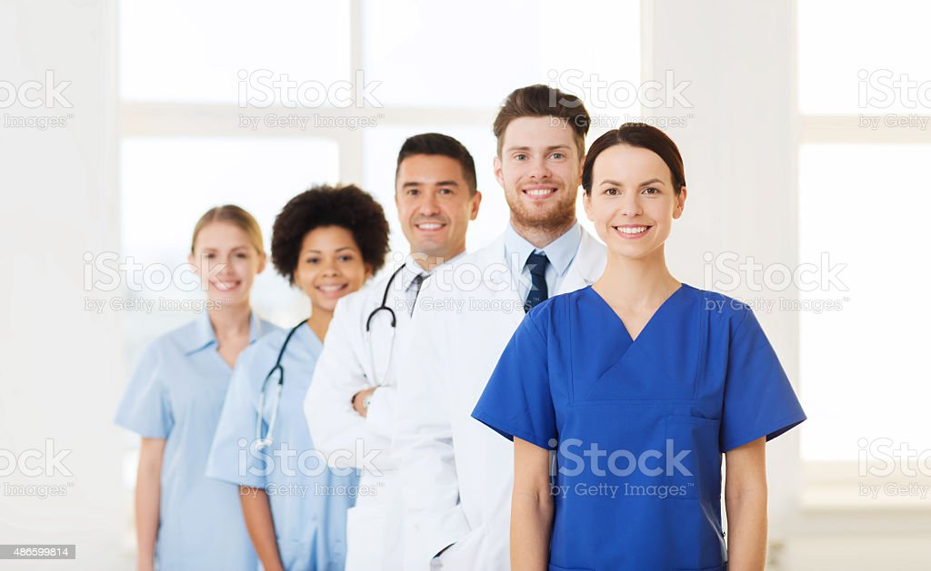 group of happy doctors at hospital stock photo
