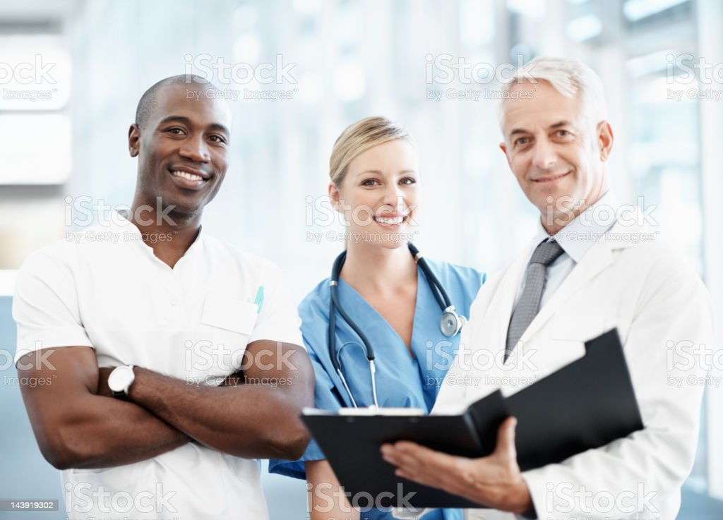 Group of happy doctors looking at you royalty-free stock photo