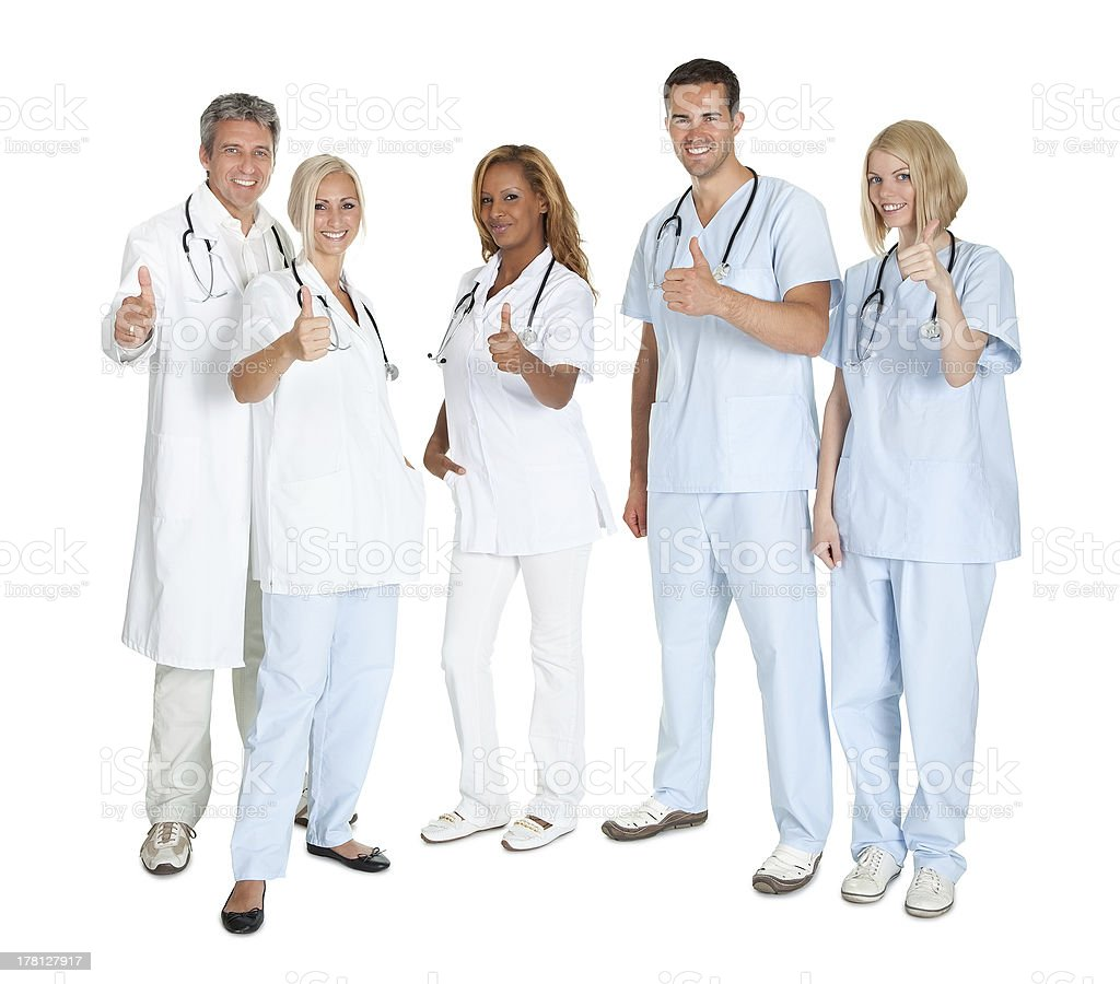 Group of happy doctors with thumbs up stock photo