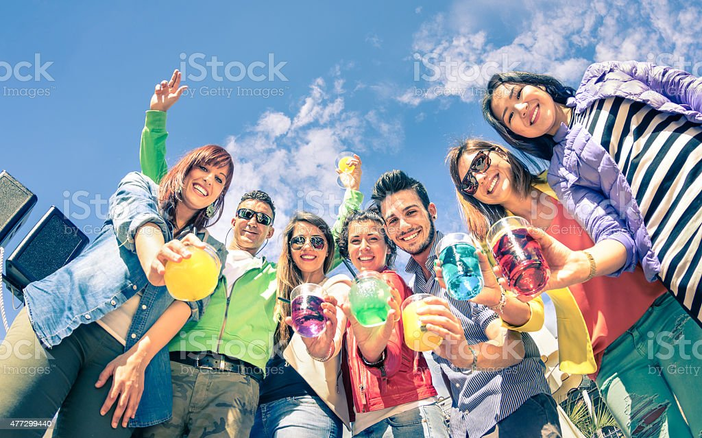 Group of happy friends having fun together at birthday party stock photo