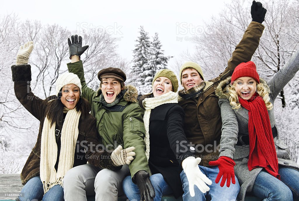 Group of happy friends outside in winter royalty-free stock photo