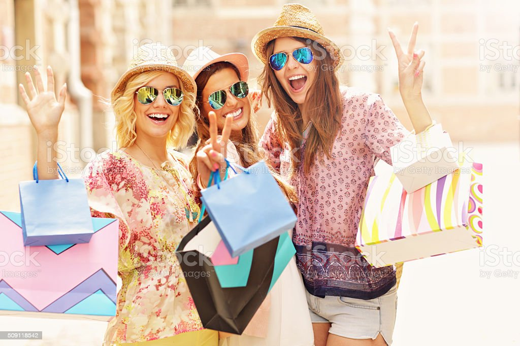 Group of happy friends shopping in the city stock photo