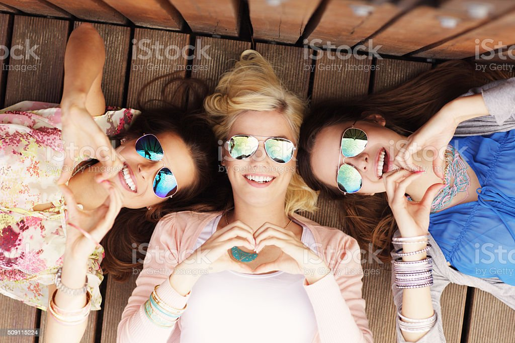 Group of happy friends showing hearts stock photo