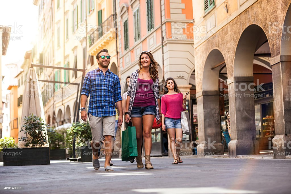 Group of happy friends walking in the city during summer stock photo