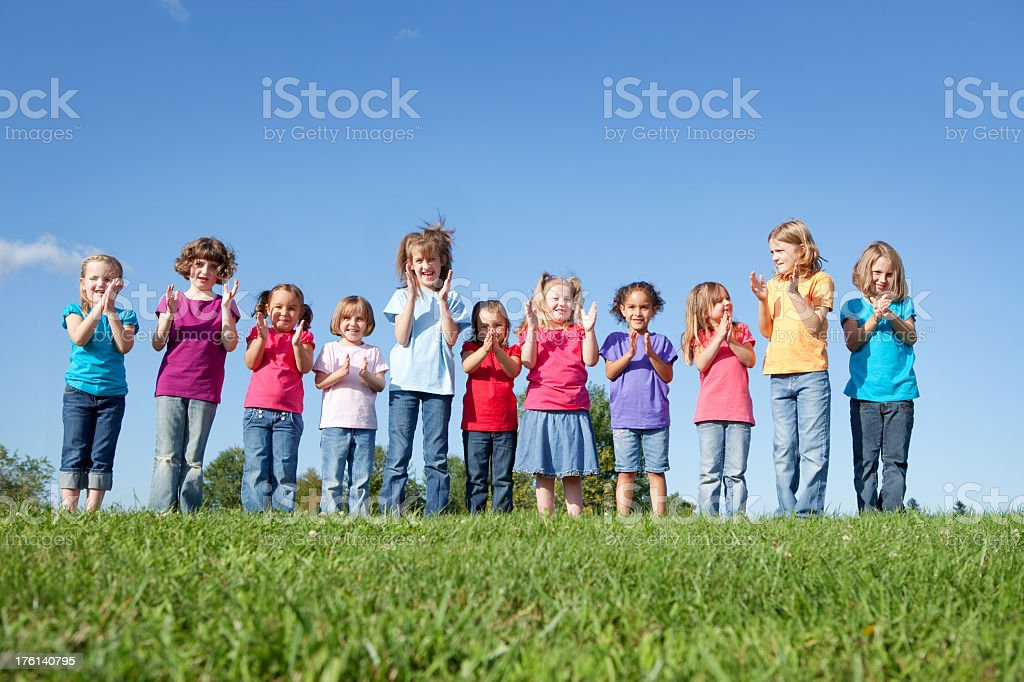 Group of Happy Girls Cheering and Clapping royalty-free stock photo
