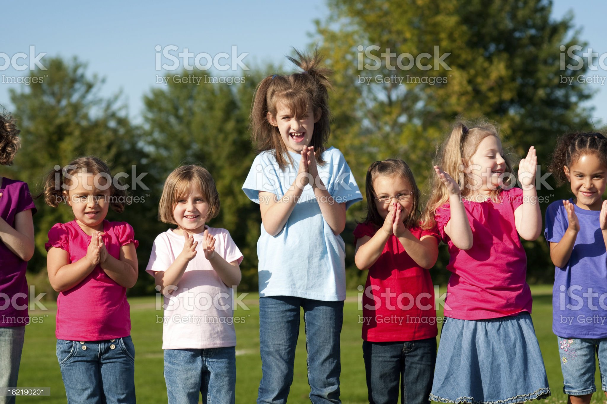 Group of Happy Girls Clapping and Laughing royalty-free stock photo