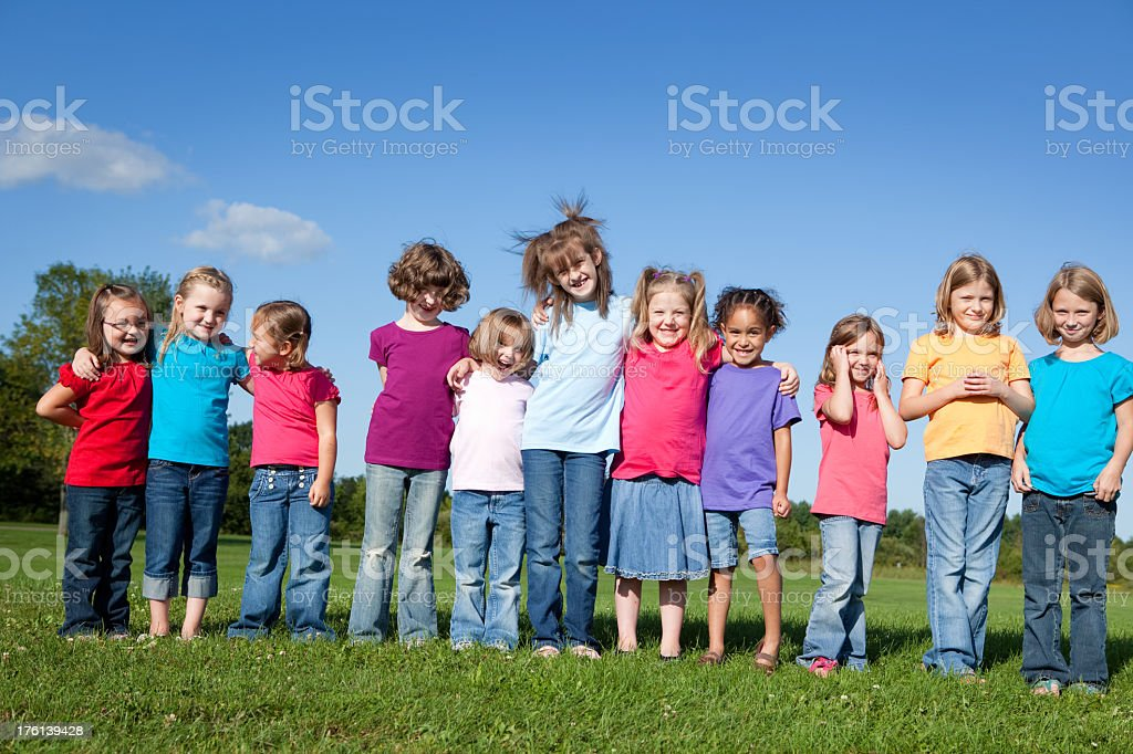 Group of Happy Girls Hugging Each Other royalty-free stock photo