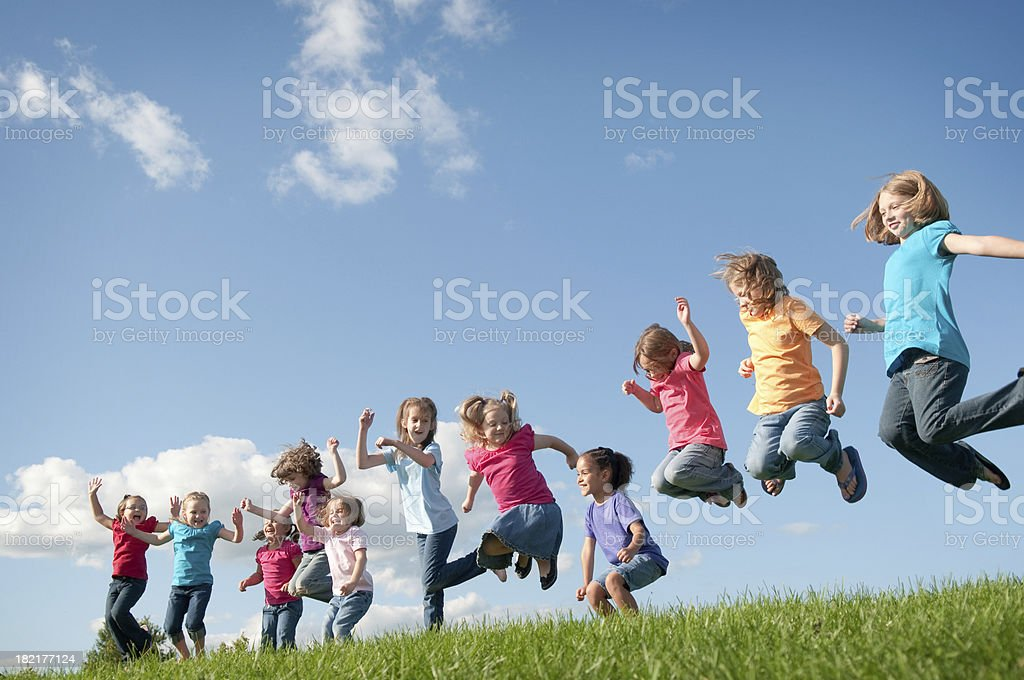 Group of Happy Girls Jumping Outside royalty-free stock photo