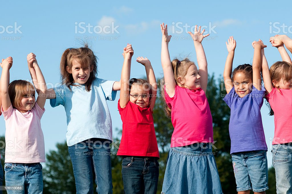 Group of Happy Girls Raising Their Hands royalty-free stock photo