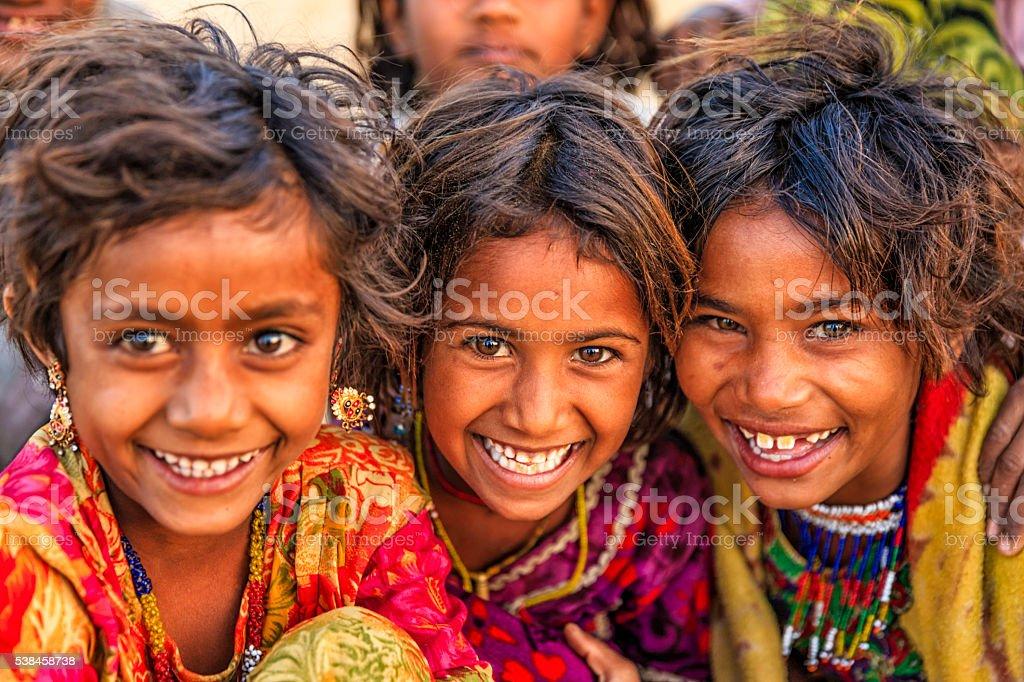 Group of happy Gypsy Indian children, desert village, India stock photo