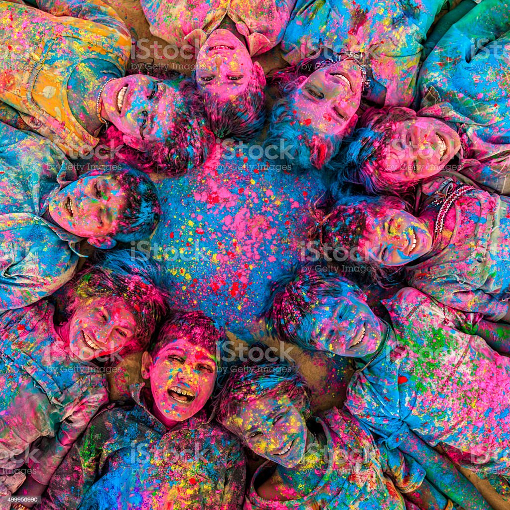 Group of happy Indian children playing holi, desert village, India stock photo
