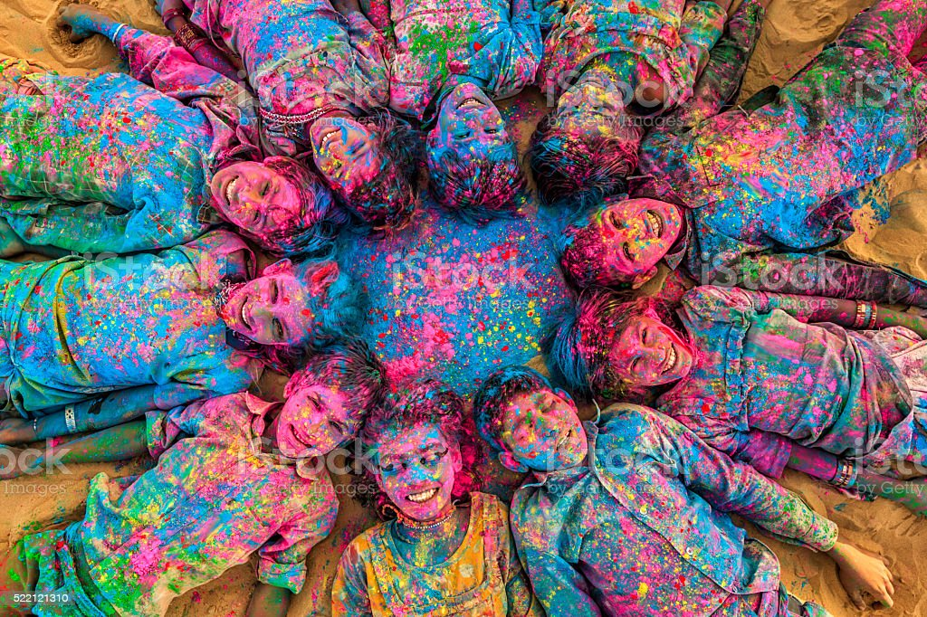 Group of happy Indian children playing holi, desert village, India stock photo