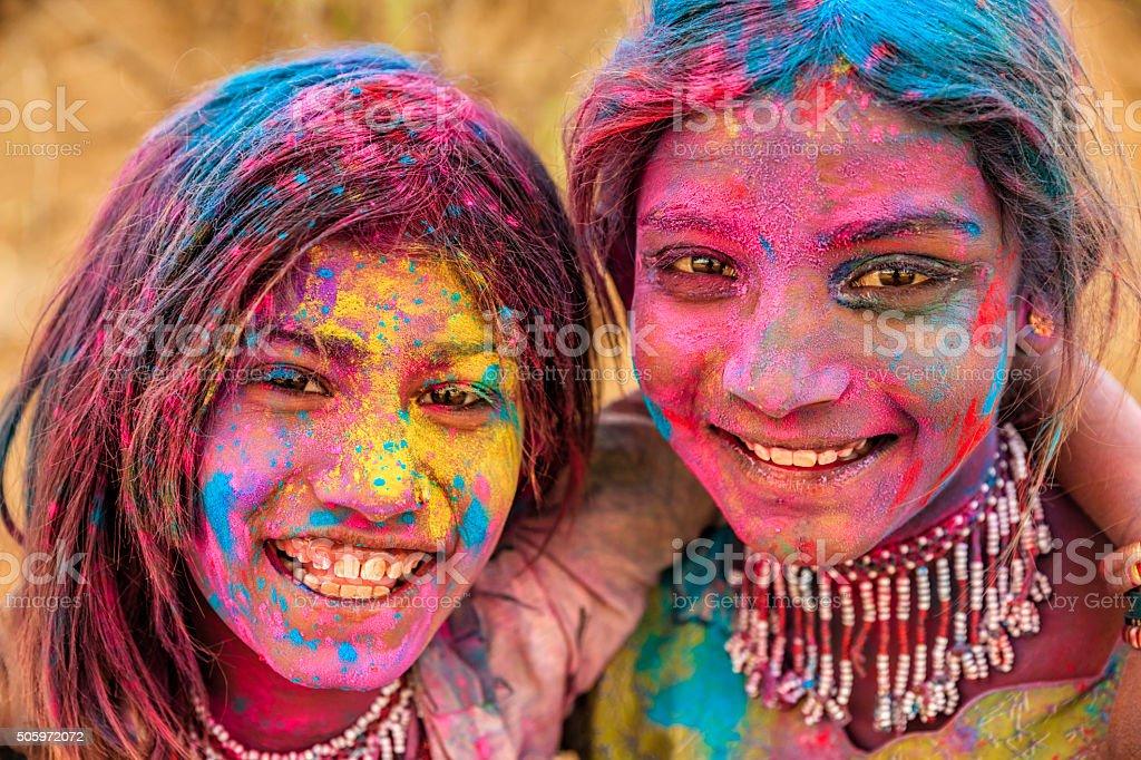 Group of happy Indian girls playing holi, desert village, India stock photo