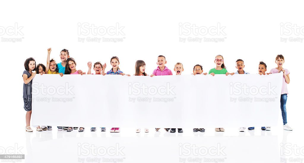 Group of happy kids holding big white banner. stock photo