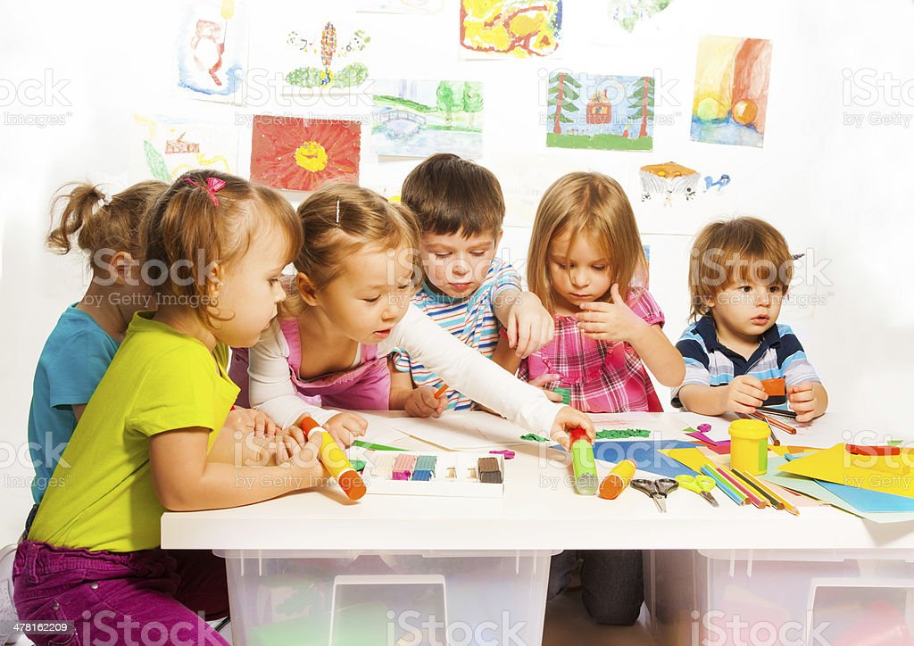 Group of happy kids painting and stock photo