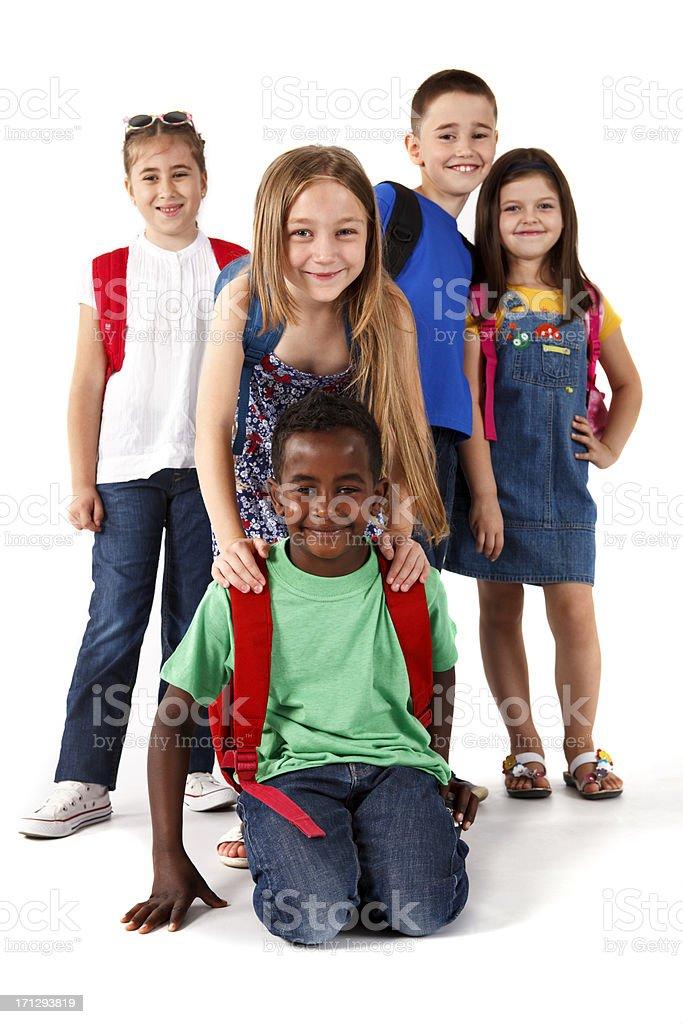 Group of happy multi-ethnic school children stock photo