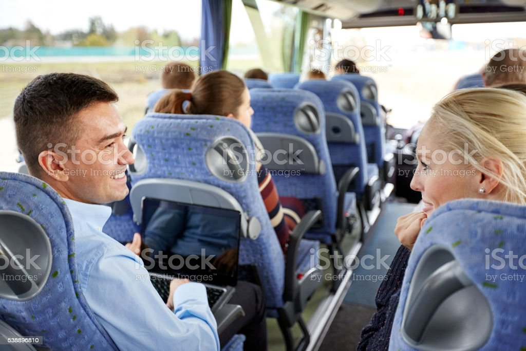 group of happy passengers in travel bus stock photo