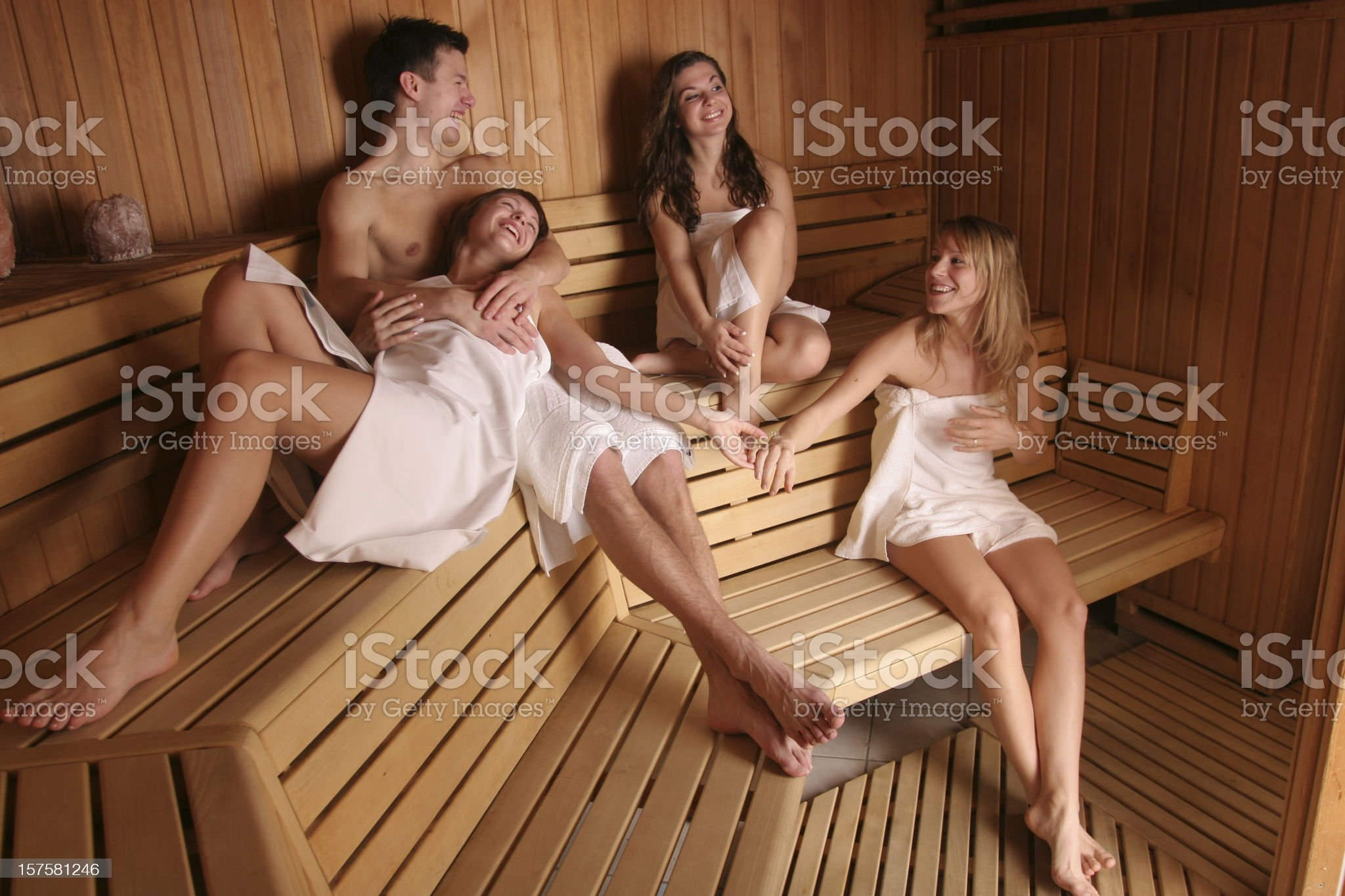 Group of happy people in sauna royalty-free stock photo