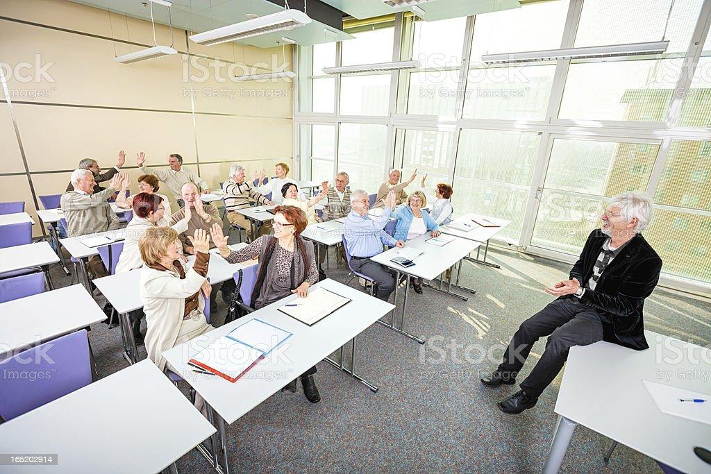Group of happy seniors on motivation seminar royalty-free stock photo