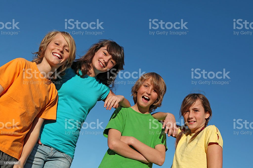 group of happy smiling kids stock photo