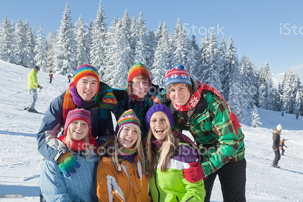 Group of happy smiling young people in ski area royalty-free stock photo