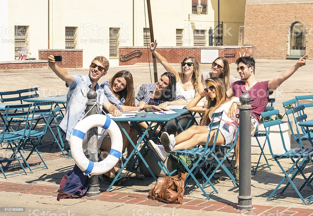 Group of happy students best friends taking a selfie stock photo