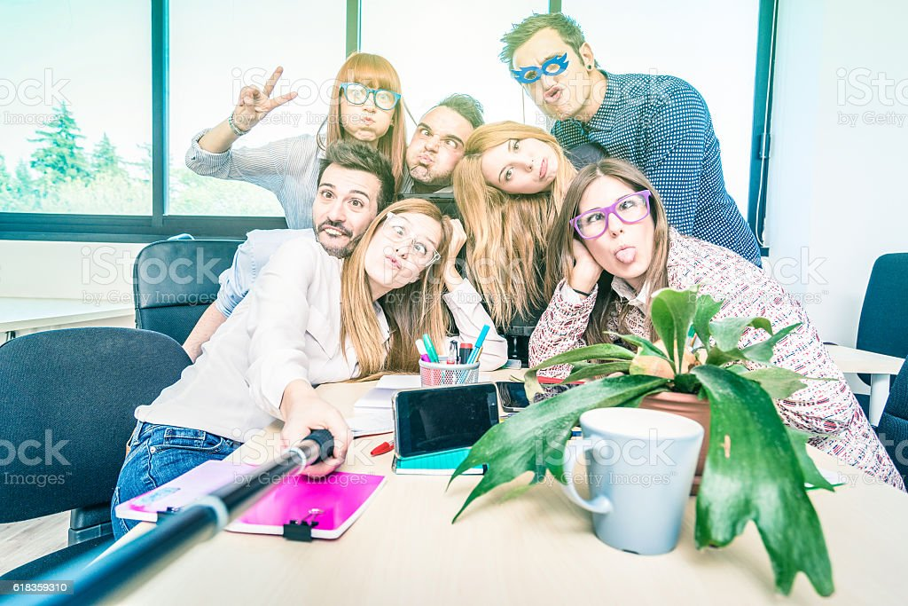 Group of happy students employee workers taking selfie at work stock photo
