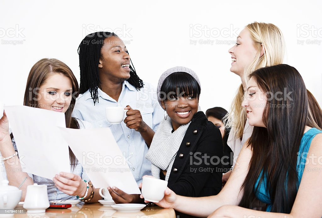 Group of happy students with documents, perhaps good exam results stock photo