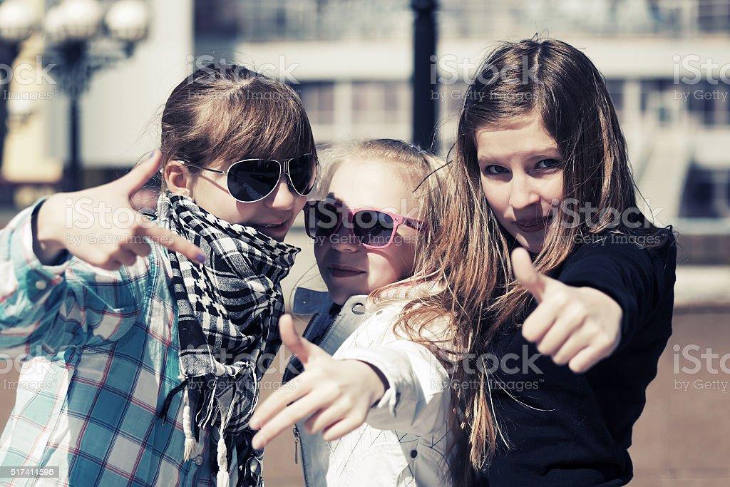 Group of happy teen girls on city street stock photo