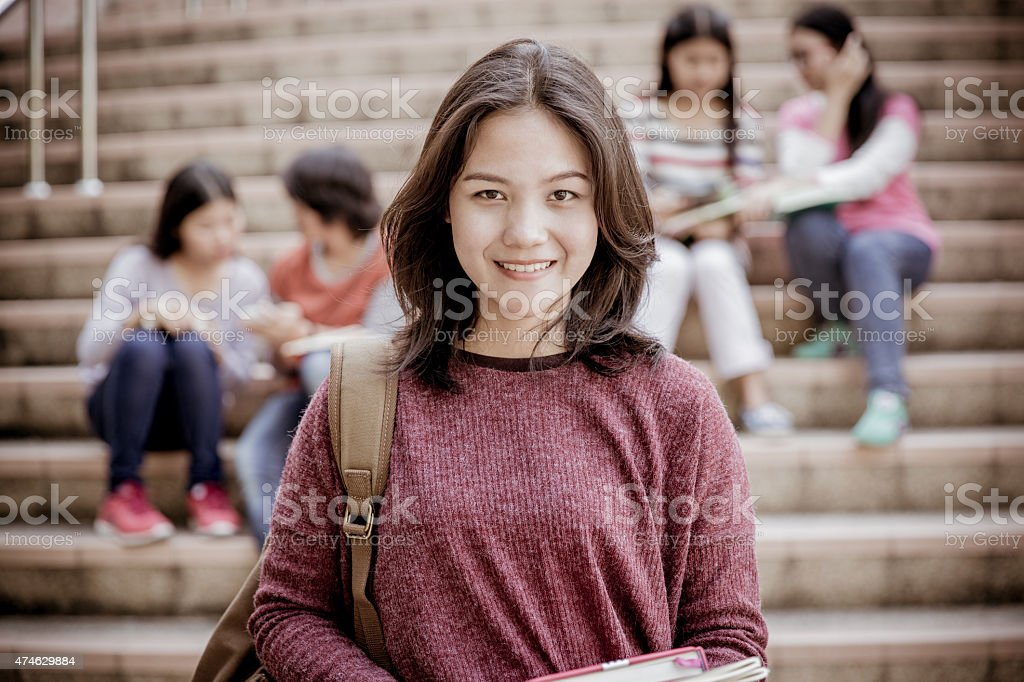 group of happy teen high school students outdoors stock photo