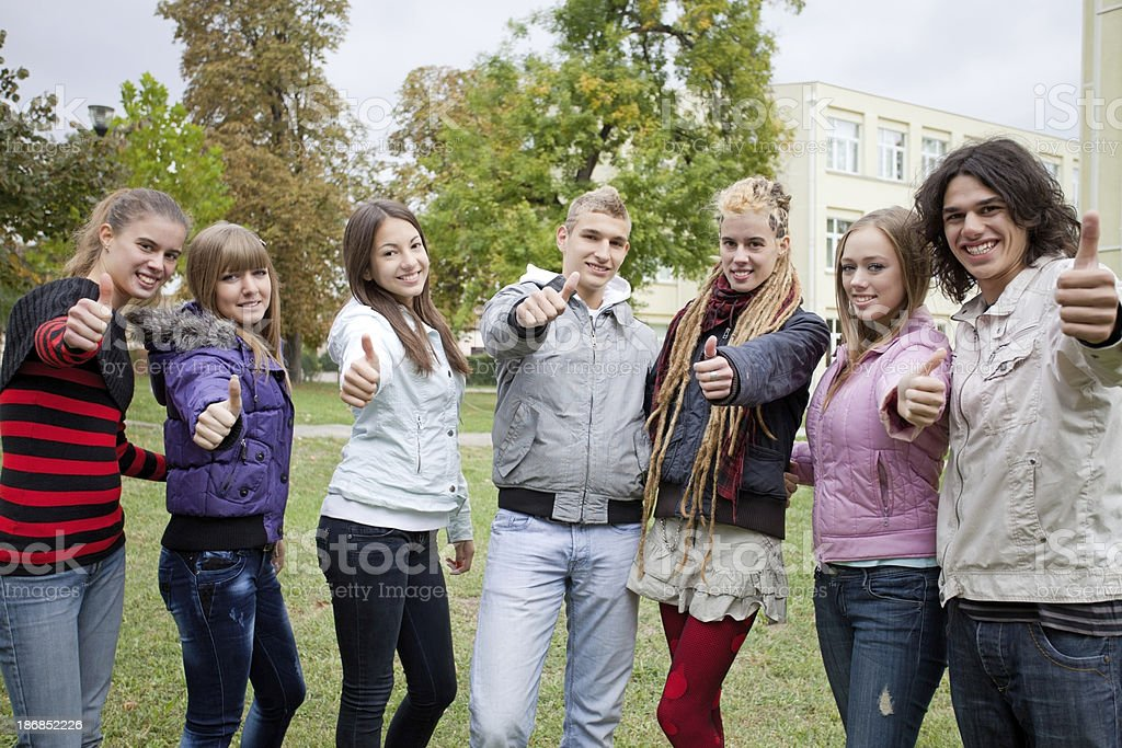 Group of happy teenagers near high school building. royalty-free stock photo