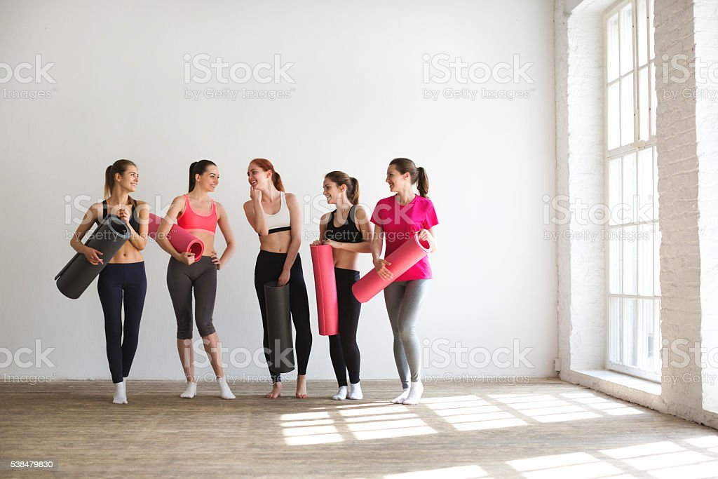 Group of happy women in gym. stock photo