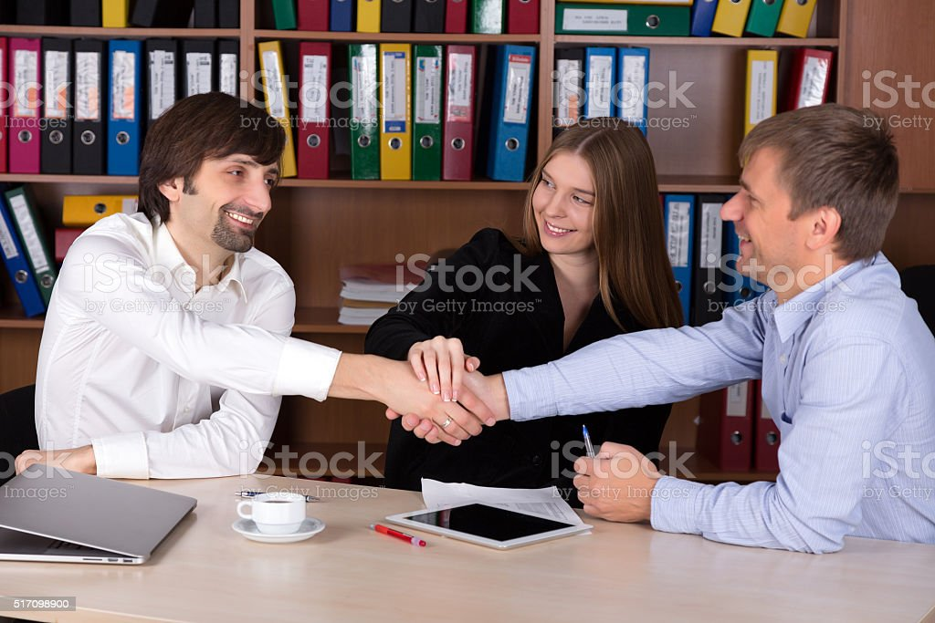Group of happy young Business People shaking Hands stock photo