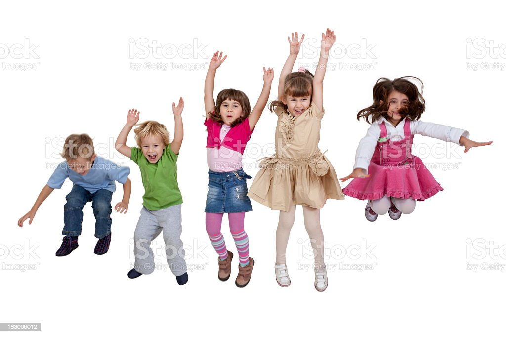 Group of happy young children jumping indoors stock photo