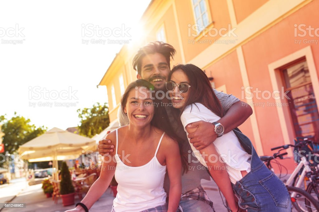 Group of happy young friends having fun stock photo