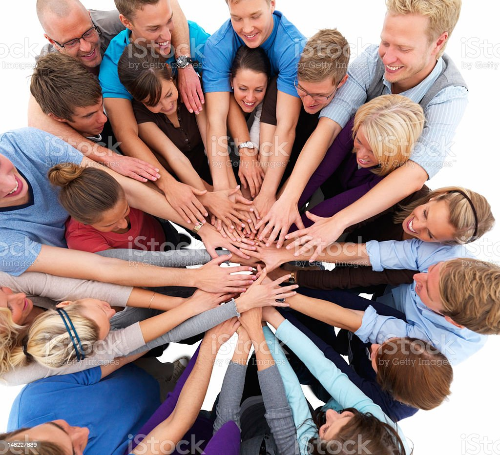Group of happy young men and women showing unity royalty-free stock photo