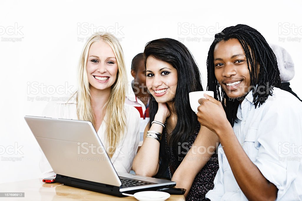 Group of happy young people round laptop in coffee shop royalty-free stock photo