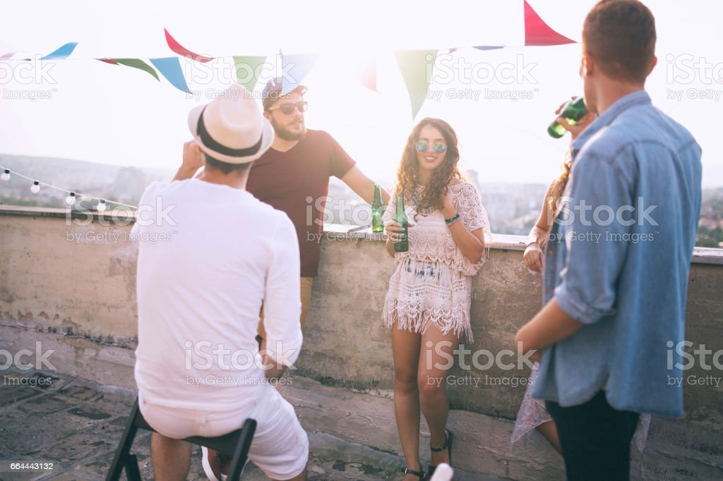 Group of happy young people standing together with drinks stock photo
