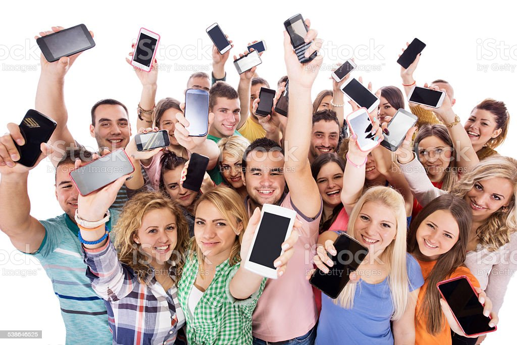 Group of happy young people with cell phones. stock photo