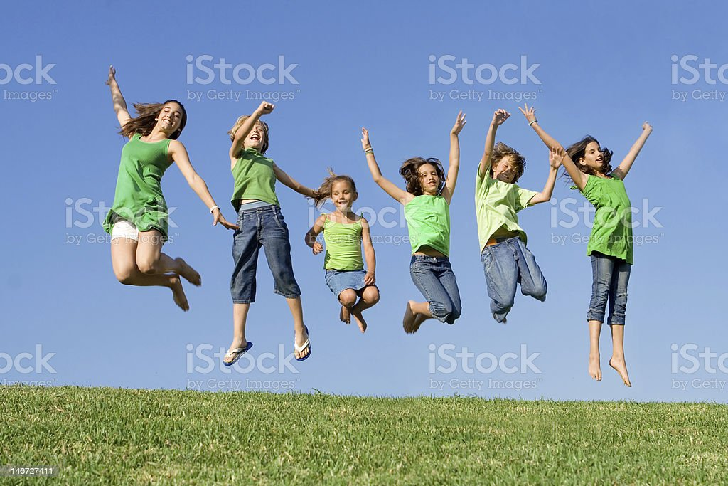 group of hapy smiling kids or children jumping stock photo
