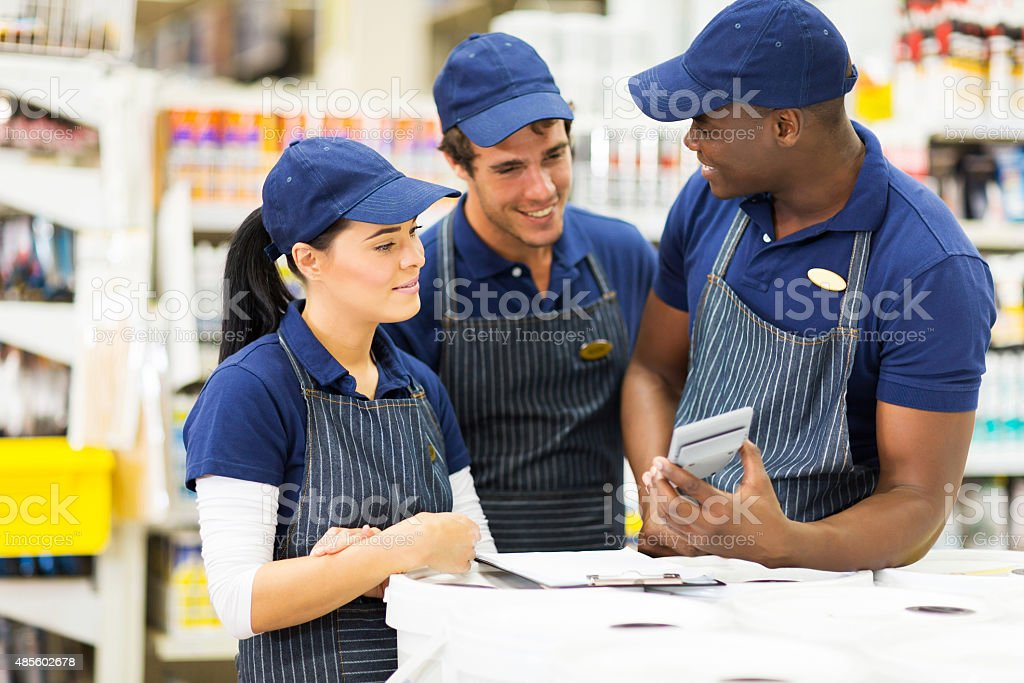group of hardware store workers stock photo